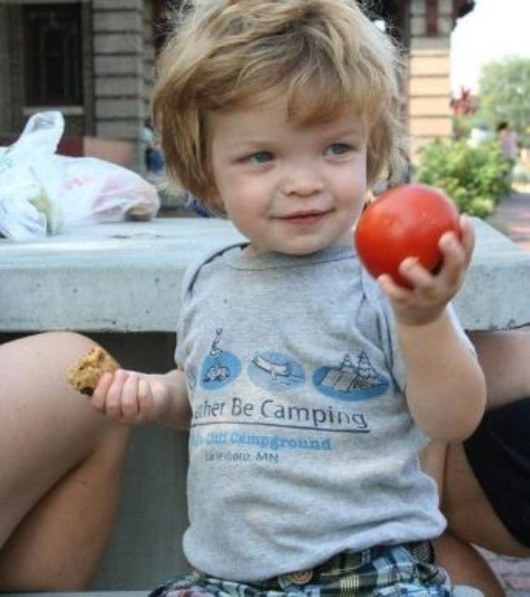 Little Boy with Tomato at Farmers Market