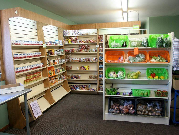 Produce Display After Remodeling with Donated Shelving to Hold Colorful Bins and a Larger Selection